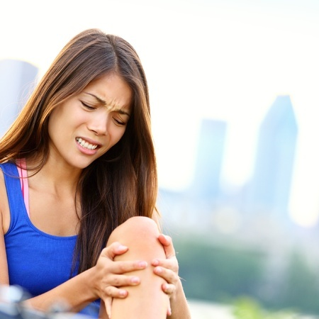 Woman runner in pain from shin splints