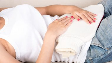 Woman suffering from irregular period pain